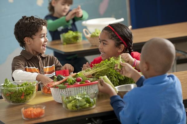 Kids preparing vegetables